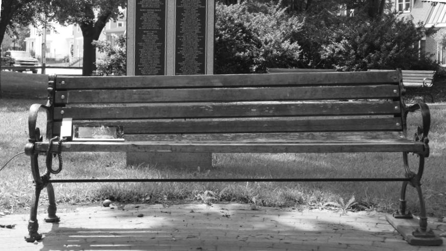 Black and white photo of a bench